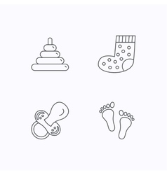 Footprint pacifier and socks icons vector image
