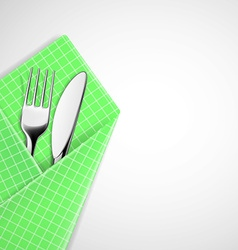 Fork and knife in a napkin vector