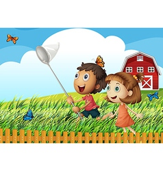 Kids catching butterflies at the field vector image