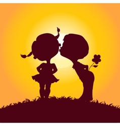 Sunset silhouettes of kissing boy and girl vector image