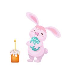 Easter cake rabbit holding easter egg vector