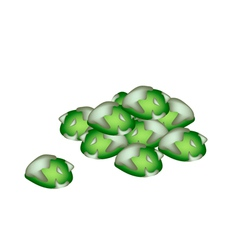 A pile of wasabi peas on white background vector