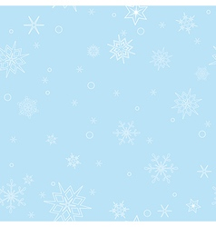 Light blue seamless pattern with snowflakes vector