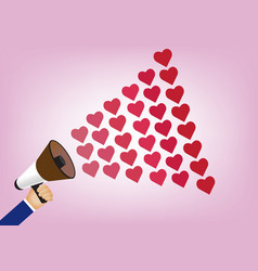 Hand holding megaphone to speech into heart vector