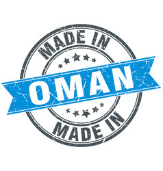 Made in oman blue round vintage stamp vector