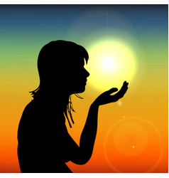 Silhouette woman on sunset holding sun in hand on vector