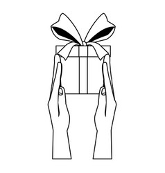 Hand holds gift box present wrapped ribbon bow vector