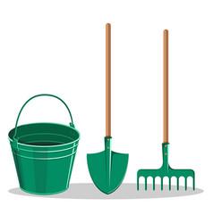 gardening bucket green shovel and rake on white vector image