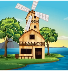 A farmhouse with a windmill vector