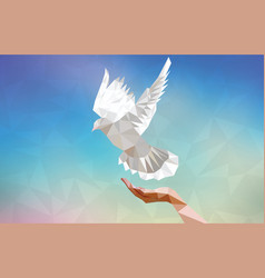Polygonal dove with human hand flying in blue sky vector