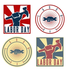 Labor Day labels with the hand of worker holding vector image
