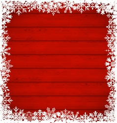 Christmas snowflakes border on wooden background - vector