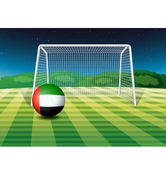 A soccer ball at the field with the uae flag vector