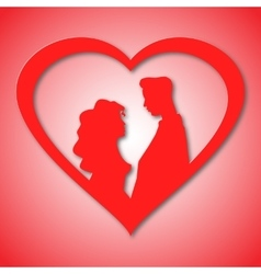 Silhouettes of loving couple in red heart card vector