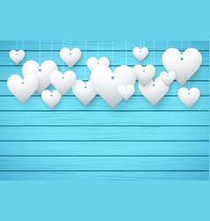 Wooden background with white hearts vector