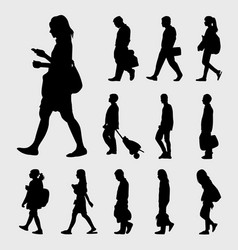 Man and woman walk silhouettes vector