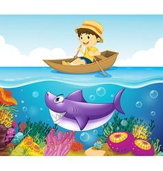 A boy in the ocean with a shark vector image vector image