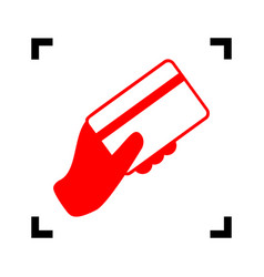 Hand holding a credit card red icon vector