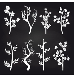White tree silhouette on chalkboard vector