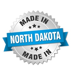 Made in north dakota silver badge with blue ribbon vector