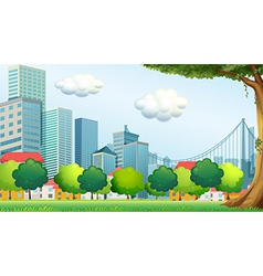 Trees near the tall buildings vector
