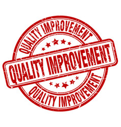 Quality improvement red grunge stamp vector