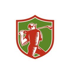 Golfer swinging club shield woodcut vector