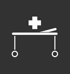 white icon on black background medical stretcher vector image