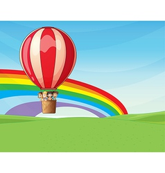 Children riding on a hot air balloon vector image
