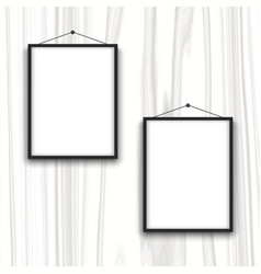 Blank frames on wood background vector