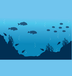 Silhouette of fish on blue ocean landscape vector