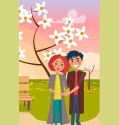 Couple hugs in park near bench and blooming tree vector