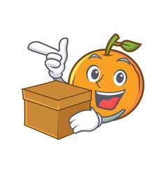 Orange fruit cartoon character with box vector