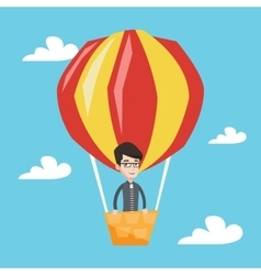 Man flying in hot air balloon vector