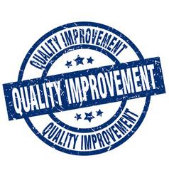 Quality improvement blue round grunge stamp vector