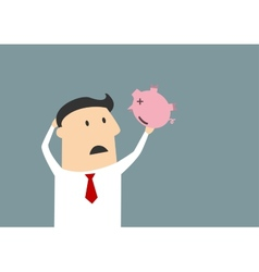 Businessman shaking empty piggy bank vector image vector image