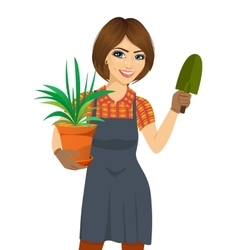 Woman holding green chlorophytum plant in pot vector