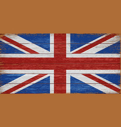 Uk flag painted on old wooden planks background vector