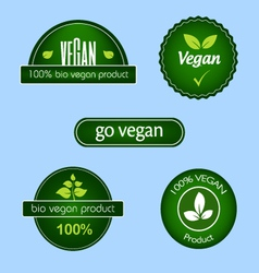 Collection of green vegan food labels and badges vector