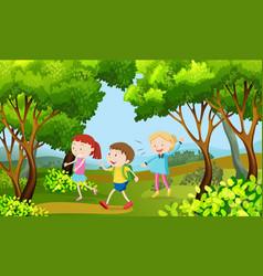 three kids walking in the woods vector image vector image