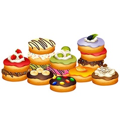 Pile of donuts with different flavors vector image vector image