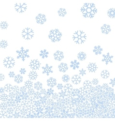 Abstract pattern of blue falling snowflakes vector
