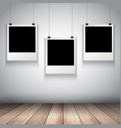 Collection of hanging blank photos vector