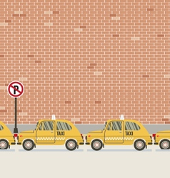 Yellow taxi parked beside pedestrian vector