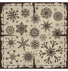 set of different snowflakes over old damaged page vector image