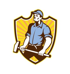 Worker wielding sledgehammer crest retro vector