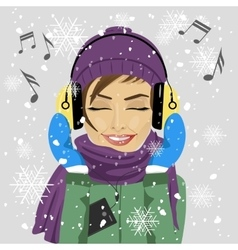 Woman listening to music with headphones in winter vector