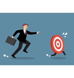 Businessman try to catch the target vector
