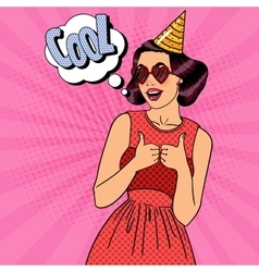 Woman having a party in celebration hat pop art vector