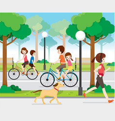 Family riding bicycle in public park vector